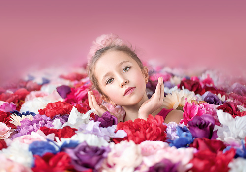 Cute little girl with a bunch of flowers
